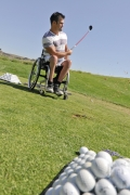 wheelchair;male;man;disabled;disability;disabled-sport;adaptive-sport;golf;adaptive-golf;driving-range;golf-course;sun;outdoors