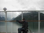 wheelchair;male;man;couple;cruise;on-deck;glacier;cruise-ship;cloudy;moody;fun;ocean;mountains