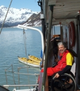 wheelchair;travel;accessible;inclusive;access;man;male;disability;disabled;alaska;glacier-bay;sea-wolf;boat;mountains;snow;water