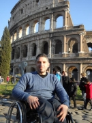 Haian-Dukhan;Rome;wheelchair;male;man;Italy;tourist;inclusive-tourism;accessible-tourism;Colosseum;travel;holiday