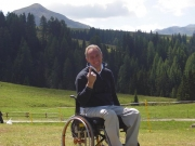 male;male;wheelchair;italy;Europe;country;meadow;mountains;alpine-paddock;grasslands;grass;lawn;smiling;fun;picnic