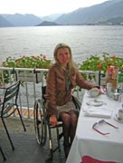 wheelchair;woman;disabled;disability;travel;tourist;accessible;tourism;inclusive-tourism;lake;mountains;terrace;dining;cafe;food;dining;italy