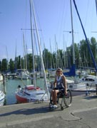 wheelchair;woman;disabled;disability;travel;tourist;accessible;tourism;inclusive-tourism;lake;marina;yacht;yachting;italy;dock;dockside