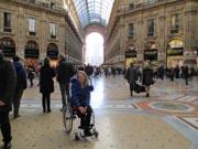 Woman-traveler-using-wheelchair-in-Milan-Italy