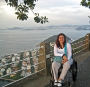 Young-woman-in-wheelchair-overlooking-the-ocean-from-hilltop-observation-point
