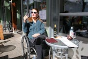 wheelchair;woman;disabled;disability;tourist;tourism;travel;holiday;Vancouver;British-Columbia;Canada;Fraser-River;Granville-Island;cafe;dining;wine;drink;bar;outdoors