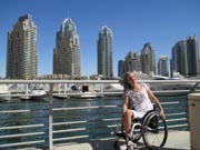 Young-woman-traveler-using-wheelchair-visiting-Dubai