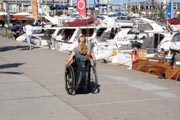 Woman-tourist-on-coastal-harbor-promenade