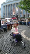 wheelchair;woman;disability;disabled;sweden;stockholm;Europe;accessible;accessibility;inclusion;travel;history;historic;craft;art;market;city-square;conbblestones