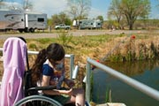 Young-girl-in-wheelchair-fishing-at-an-RV-park