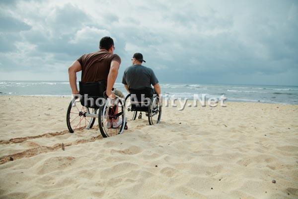 Wheelchair tracks across the beach