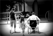 Father-in-wheelchair-with-his-children-crossing-the-road