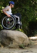Man in a wheelchair tackling some extreme offroad trails