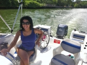 Young-woman-in-wheelchair-driving-boat