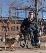 Man-using-wheelchair-walking-his-dog-with-the-Orochi-Scileash
