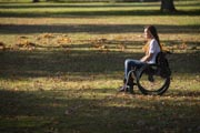 Young-woman-in-wheelchair-in-park-in-Fall.