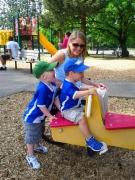 Woman-in-wheelchair-with-her-grandchildren-at-playground