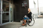 Young-woman-in-wheelchair-at-an-indoor-climbing-centre