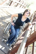 Young-woman-in-wheelchair-on-an-historic-bridge-