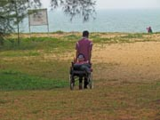 Man-in-wheelchair-at-the-beach