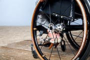 Woman-in-wheelchair-on-beachside-boardwalk