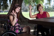 Two-woman-using-wheelchairs-at-park-picnic-table