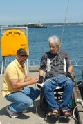 wheelchair;travel;accessible;inclusive;access;man;male;disability;disabled;dock;yacht;dock-hoist;jetty;catamaran;gato-verde-sailing-adventures;bellingham;usa;washington-state
