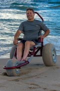 Man-enjoying-the-ocean-in-beach-wheelchair