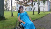 Woman-in-wheelchair-in-an-evening-gown-in-the-garden-of-stately-mansion