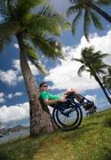 Man-in-wheelchair-enjoying-an-Hawaiian-coastal-park