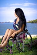 Young-woman-in-wheelchair-in-coastal-park