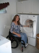 wheelchair;access;accessible;inclusion;woman;female;landry;accessible-appliance;dryer;washing