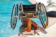 wheelchair;pool;disabled;sun;florida;wet;swim;disability;disabled;man;male;family;fun