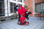 Woman-using-wheelchair-and-her-friend-outside-their-office-building