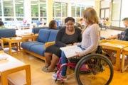 Young-female-student-in-wheelchair-on-campus