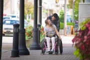 Young-woman-in-wheelchair-out-for-days-shopping