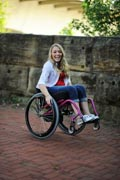 blonde-hair;casual;disability;disabled;female;fun;garden;girl;long-hair;outdoors;outside;smiling;wheelchair;woman;young-woman