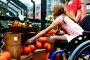 wheelchair;disability;disabled;family;shopping;market;halloween;pumpkin;shops;street-stall;girl;sidewalk