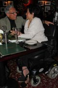 Woman-in-power-wheelchair-on-romantic-dinner-date