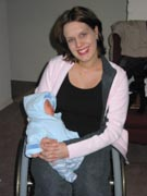 Mother-in-wheelchair-with-her-newborn-baby