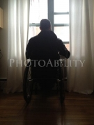 wheelchair;male;man;accessible;accessibility;inclusion;inclusive;disabiled;disability;backlight;window;indoor