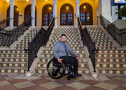 Young-man-in-wheelchair-in-front-of-staircase