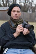 Portrait-of-disabled-male-photographer-in-wheelchair