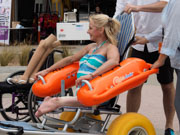 St-Kilda,-Melbourne,-Australia.-9-Dec,-2017.-St-Kilda-is-now-home-to-Australia-s-most-accessible-beach,-following-Port-Phillip-Councils-launch-there-today-of-beach-wheelchairs-and-matting-to-ensure-people-with-disabilities-can-enjoy-day-at-the-Bay.-Bilateral-amputee-and-City-of-Port-Phillip-Metro-Access-Officer-Amanda-Lawrie-Jones-testing-out-the-beach-wheelchair.