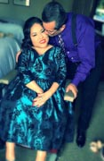 Woman-using-power-wheelchair-at-formal-reception-with-her-husband