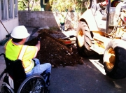Construction-worker-in-wheelchair-Inspecting-archaeological-trench