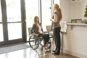Young-professional-woman-in-wheelchair-in-an-office