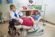 Woman-dentist-using-wheelchair-in-her-examination-room