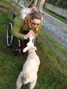 Woman-in-wheelchair-feeding-baby-animal