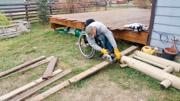 Man-using-wheelchair-constructing-planter-box